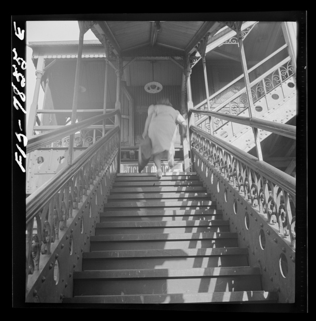 New York, New York. Third Ave elevated railway steps at the 94th Street Station in the early morning