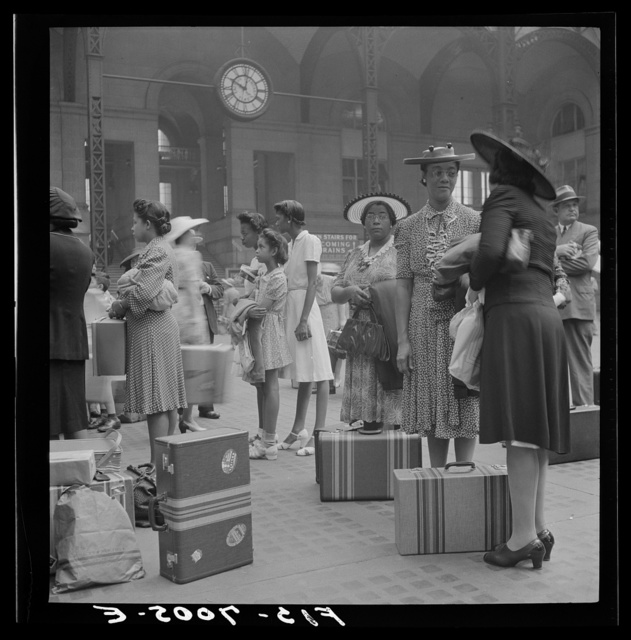 New York, New York. Waiting for the trains at the Pennsylvania railroad station