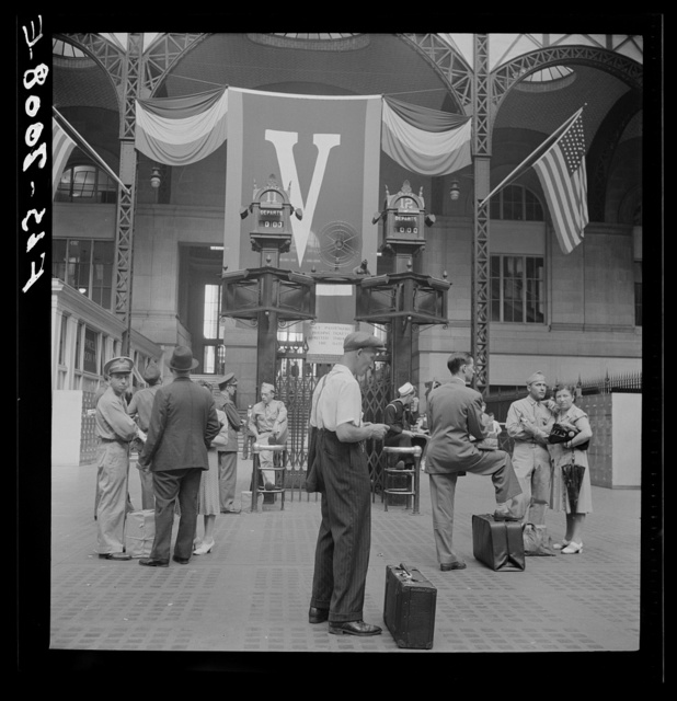 New York, New York. Waiting for trains at the Pennsylvania railroad station