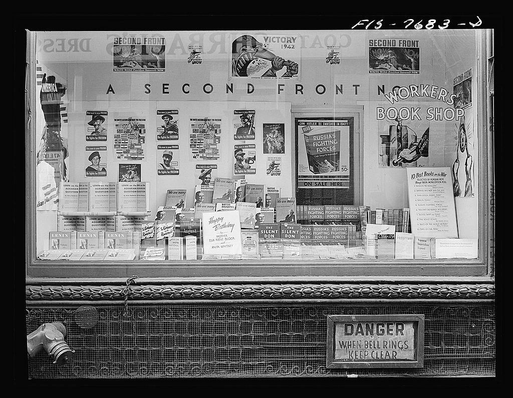 New York, New York. Workers' bookshop in a building on 13th Street between University Place and Broadway, which is the headquarters of the Communist party. No mention of Communism appears in the display or on the building