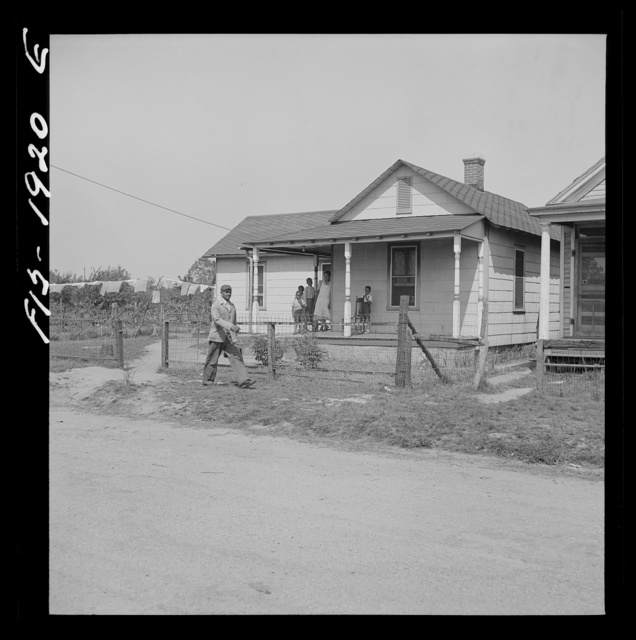 Newport News, Virginia. Negro shipyard worker leaving his rural home for the shipyards with his lunch box