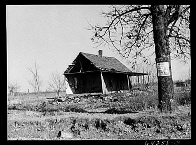 Newton County, Missouri. Camp Crowder area. Farmhouses on land bought by the Army are demolished when construction work moves close to them