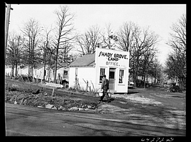 Newton County, Missouri. Camp Crowder area. Tents, trailers and cabins stretch along U.S. Highway No. 71 for ten miles bordering the construction area
