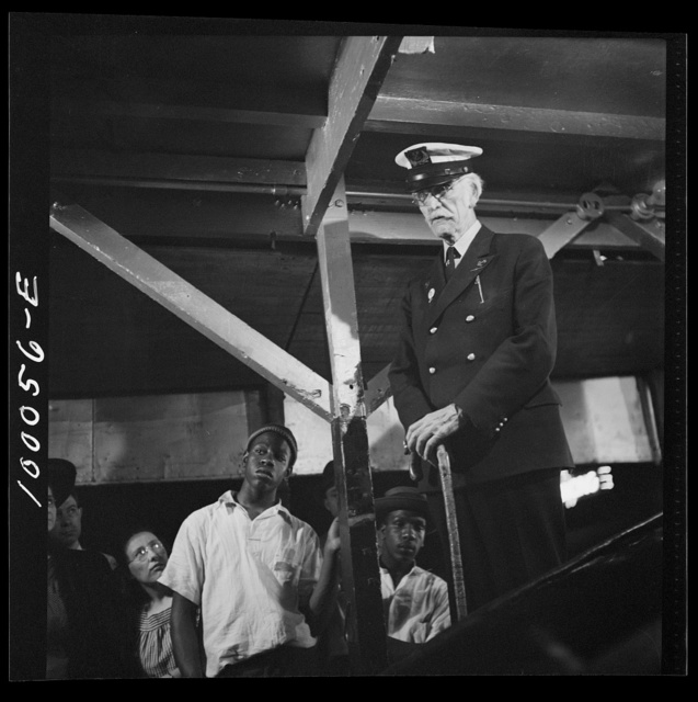 Norfolk, Virginia. Impresario in a travelling railroad show, who pretends to be a sea captain who captured the whale on exhibit in the show