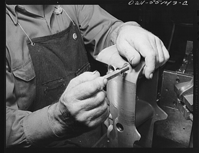 North American Aviation, Inc., Inglewood, California. Hands of a skilled machinist working on a part for a B-25 bomber or P-51 fighter