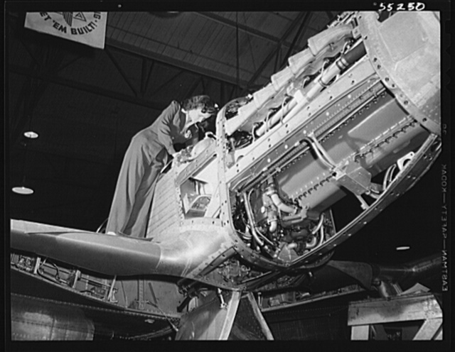 North American Aviation's new P-51 Mustang fighter for the United States Army Air Forces receives its final assemblies before moving out the door to the flight ramp