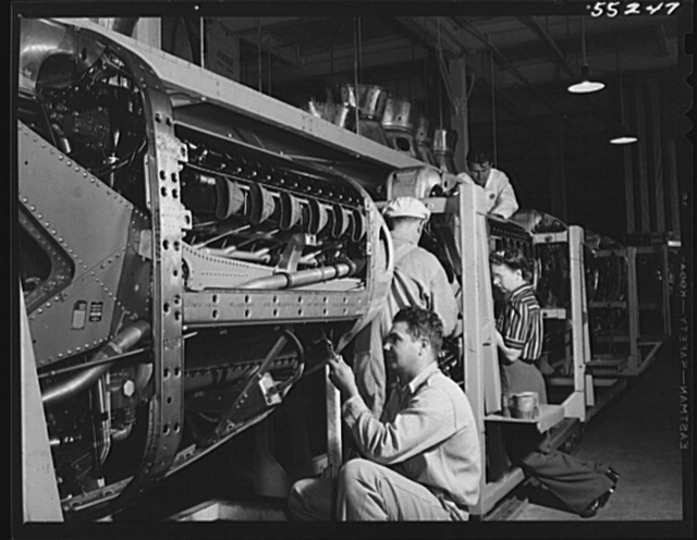 North American employees assemble the cowling on Allison motors for the P-51 fighters