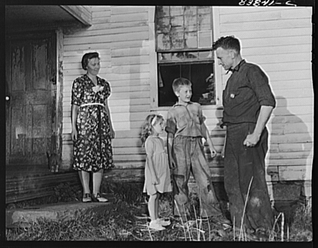 Norwich, Connecticut (vicinity). Swedish farmer who also works in defense plant to pay off debt on farm. He has just arrived home from the factory and in a few minutes will be doing odd chores around the farm