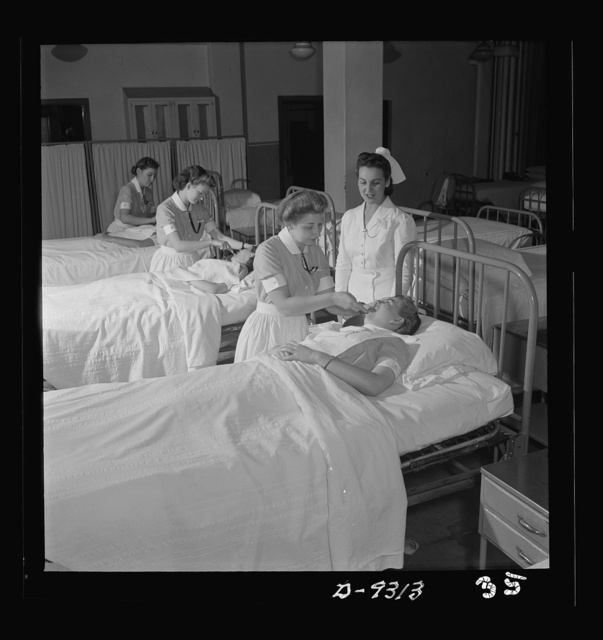 Nurse training. First-year students practice various sick-room techniques on one another. They will soon be ready for work in the wards