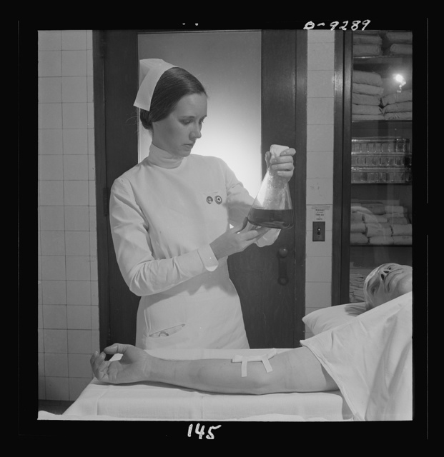 Nurse training. Immediately following a blood transfusion the nurse must whirl the container to prevent coagulation