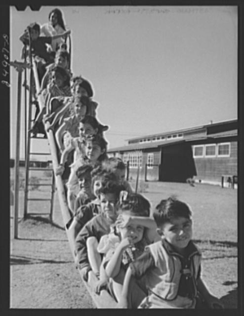 Nursery school children in playground. Robstown camp, Texas