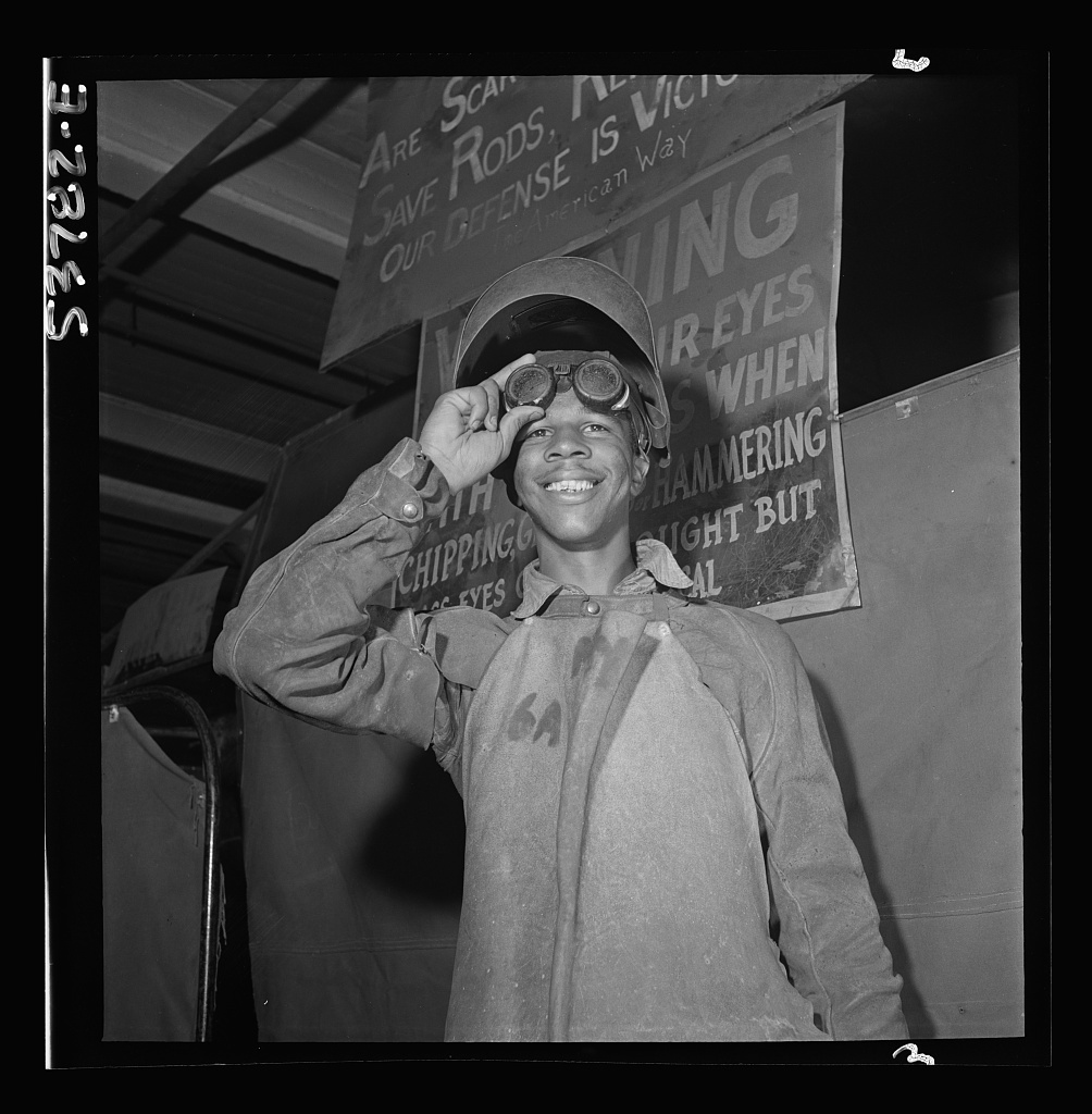 NYA (National Youth Administration) Center, Brooklyn, New York. A Negro who is receiving training in machine shop practice shown in his welder's outfit