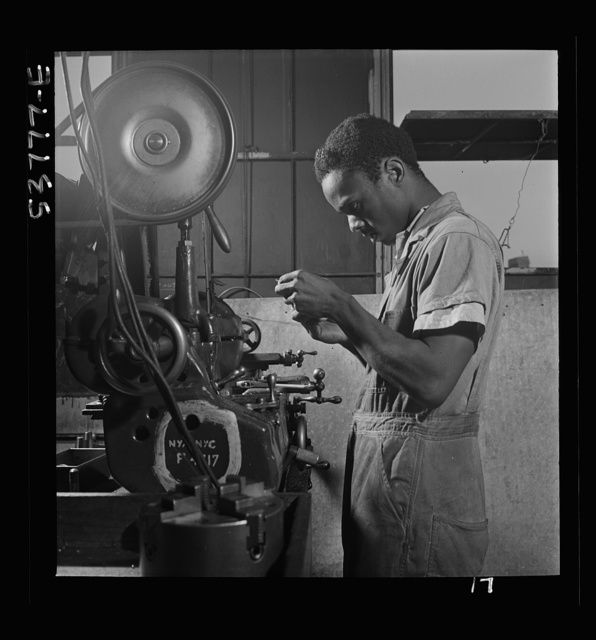NYA (National Youth Administration) work center, Brooklyn, New York. A Negro turret-lathe worker, who is receiving training in machine shop practice, learning a filing operation on a turret lathe