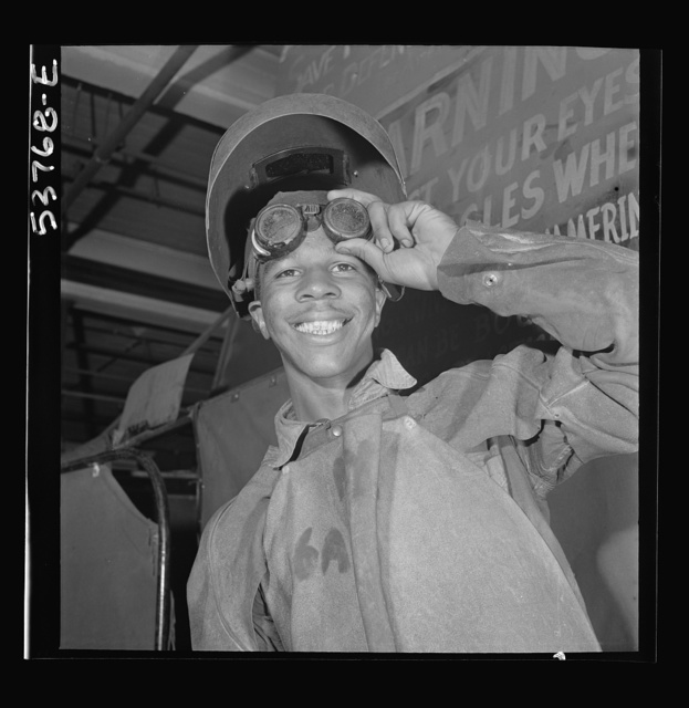 NYA (National Youth Administration) work center, Brooklyn, New York. A Negro who is receiving training in machine shop practice shown in his welder's outfit