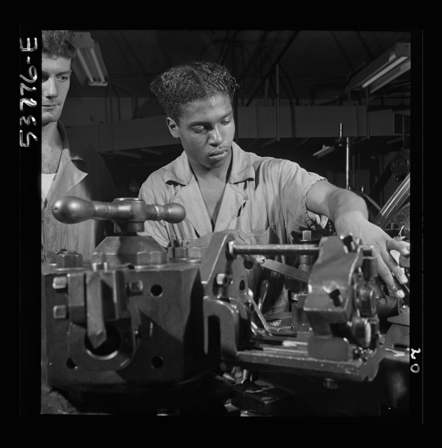 NYA (National Youth Administration) work center, Brooklyn, New York. Turret-lathe workers, Negro and white, who are receiving training in machine shop practice, carrying out an operation on a turret lathe