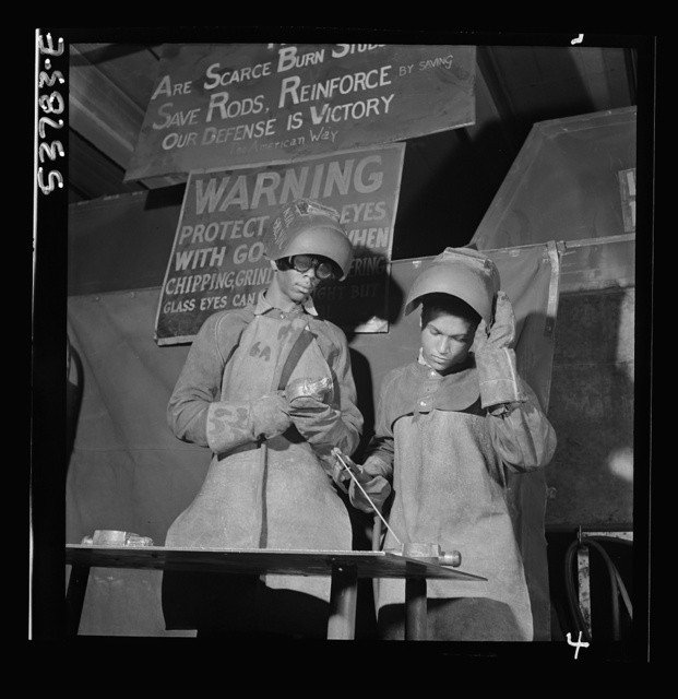NYA (National Youth Administration) work center, Brooklyn, New York. Two welders, who are receiving training in machine shop practice, building up an undersize shaft by arc welding to be re-machined to size
