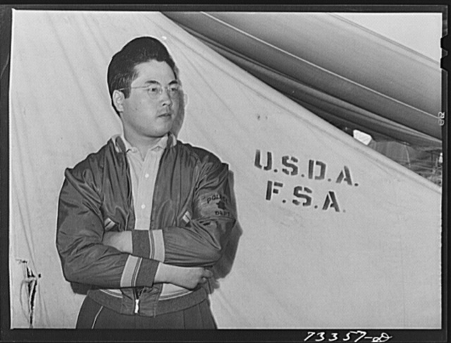 Nyssa, Oregon. FSA (Farm Security Administration) mobile camp. Japanese-American who is part of the voluntary police force. The Japanese-American evacuees have their own police force