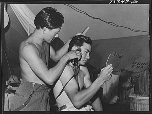 Nyssa, Oregon. FSA (Farm Security Administration) mobile camp. Japanese-Americans cut each other's hair. Under the agreement among the Japanese to FSA and those who sponsor the Japanese in the area (the United States Employment Service and the sugar beet companies), the Japanese can go into town once a week in a supervised group