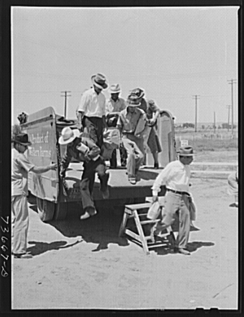 Nyssa, Oregon. FSA (Farm Security Administration) mobile camp. Sugar beet companies furnish transportation to town for Japanese-American farm workers
