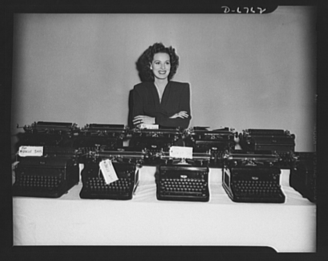 Off to war! These typewriters, which in the past have recorded scores of screen stories and many of the most memorable scenes in hit motion pictures, are now going to war. Maureen O'Harra put her personal typewriter in with the machines from the script department just before they were turned in by RKO Radio