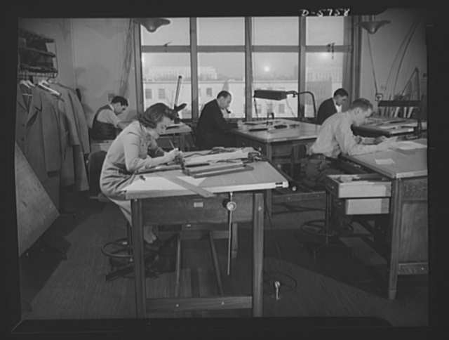 Office equipment used by the War Production Board (WPB). Drafting room where charts, diagrams, exhibits, graphs and other pictorial reports are prepared for the WPB. This department creates many vivid visualizations of statistical data such as ships being built, steel needed and production comparisons