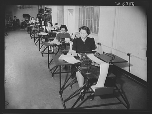 Office equipment used by the War Production Board (WPB). Some of the twenty-four form-writing machines used by the WPB to write control cards (PD-1A) for applicants for preference ratings