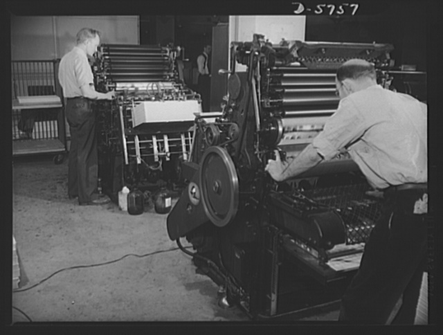 Office equipment used by the War Production Board (WPB). These Webendorger automatic offset presses are the largest of the types of offset presses in the WPB's duplicating department. These machines are in operation twenty-four hours a day and turn out 5,000 prints an hour