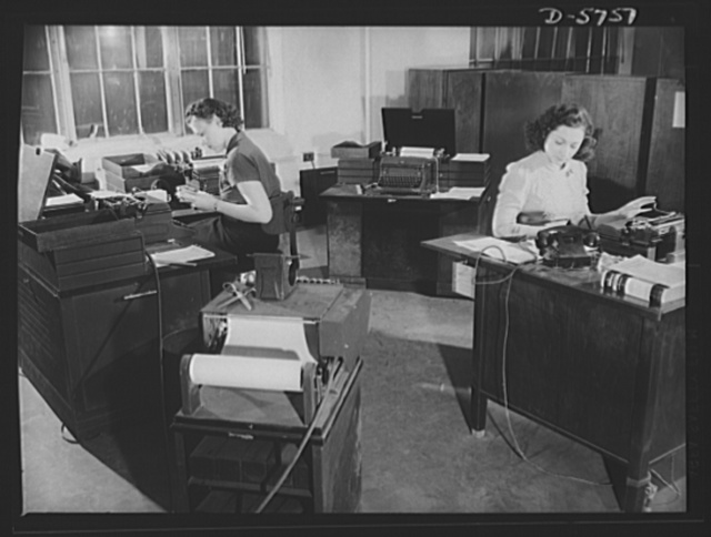 Office equipment used by the War Production Board (WPB). Three automatic typewriters are used to turn out the many form letters which the WPB operations necessitate. These typewriters multiply production, reduce typing time and costs