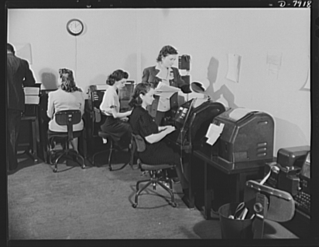 Office of War Information News Bureau. Disseminating war news is the primary task of the News Bureau of the OWI. This is the teletype room of OWI--the nerve center of the world news of the war. These instruments connect OWI offices all over the world