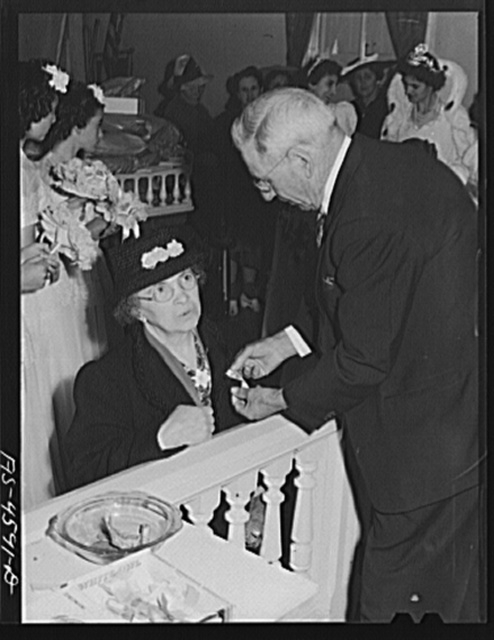 Officer of Sociedade do Espirito Santo corporation (SES), Portuguese-American society, pins badge of the fiesta of the Holy Ghost on member of the society. Santa Clara, California