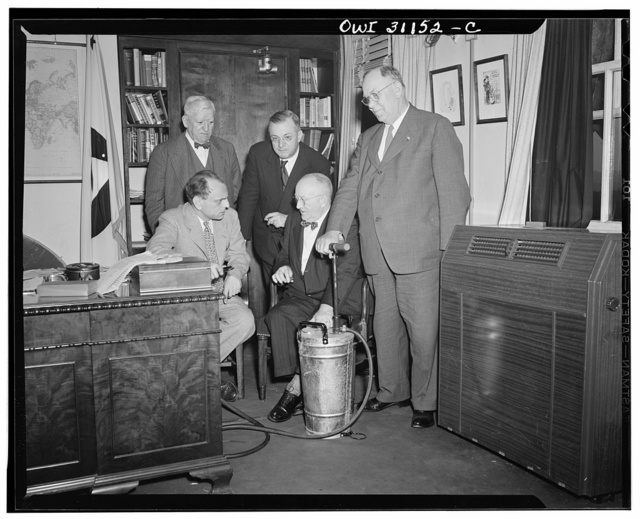Officers of International Association of Fire Chiefs confer with James M. Landis, Director of Civilian Defense, on plans for organization of Civilian Defense Fire Guard units. Left to right: (sitting) Director Landis; Fire Chief M.E. Callahan, Harrison, New Jersey; President, International Association of Fire Chiefs; (standing) Chief Daniel B. Tierney, Arlington, Massachusetts, Secretary of the Association; Fred Shepyard, New York City, Association Headquarters Manager; and Chief George Mitchell, East Orange, New Jersey, Treasurer, Eastern Association of Fire Chiefs
