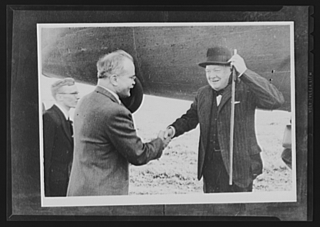Official pictures of meeting of Stalin, Churchill, Harriman. These are the first official pictures released in the United States of the recent meetings of Premier I.V. Stalin, Union of Soviet Socialist Republics; Prime Minister Winston Churchill of Britain; and W. Averrell Harriman, representing President Roosevelt. The three men met in the middle of August, 1942, at the request of the Soviet leader, and held a series of conversations concerned with the future conduct of the war. Also present was V.M. Molotov, Peoples' Commissar for Foreign Affairs, Union of Soviet Socialist Republics. The meetings lasted four days. Left to right, foreground: Molotov greeting Churchill at Moscow civil airport. Man in background is the interpreter