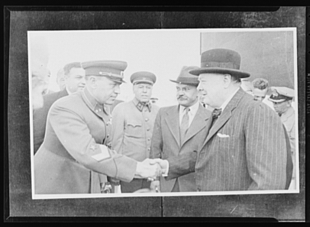 Official pictures of meeting of Stalin, Churchill, Harriman. These are the first official pictures released in the United States of the recent meetings of Premier I.V. Stalin, Union of Soviet Socialist Republics; Prime Minister Winston Churchill of Britain; and W. Averrell Harriman, representing President Roosevelt. The three men met in the middle of August, 1942, at the request of the Soviet leader, and held a series of conversations concerned with the future conduct of the war. Also present was V.M. Molotov, Peoples' Commissar for Foreign Affairs, Union of Soviet Socialist Republics. The meetings lasted four days. Commandant of the city of Moscow welcomes Churchill while Molotov and other Russian officials look on