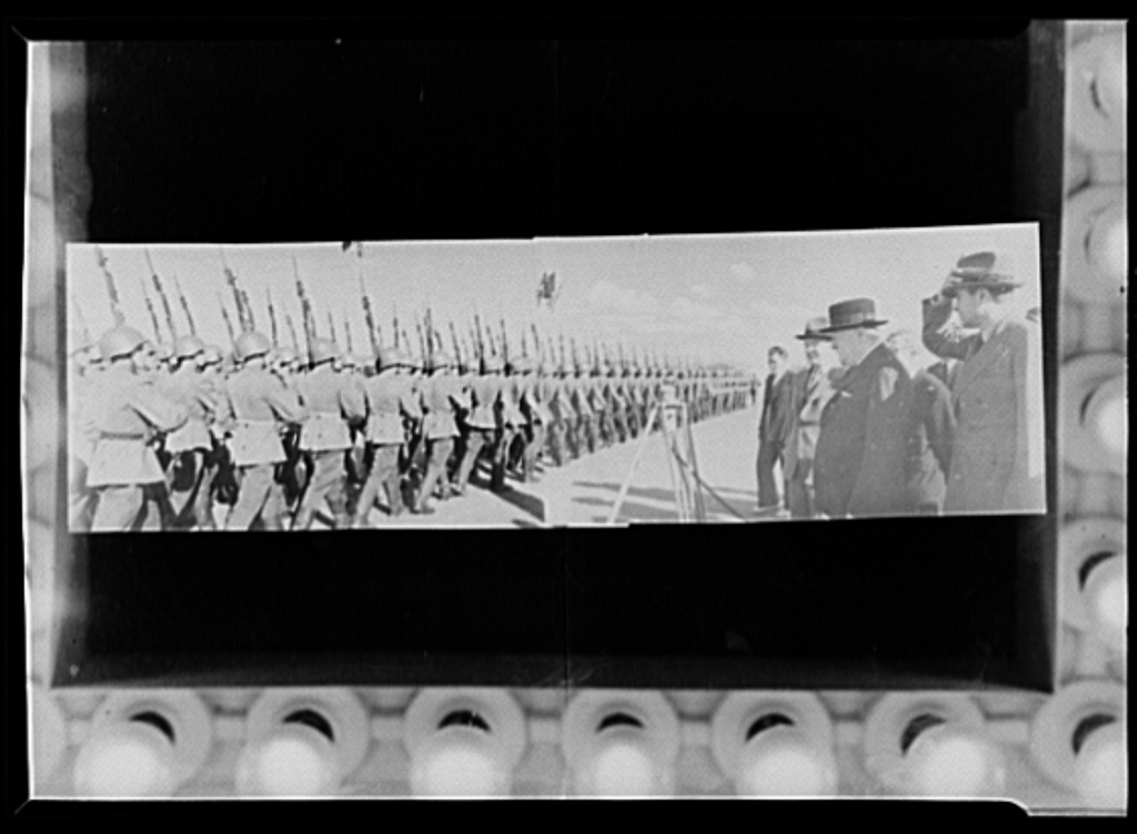 Official pictures of meeting of Stalin, Churchill, Harriman. These are the first official pictures released in the United States of the recent meetings of Premier I.V. Stalin, Union of Soviet Socialist Republics; Prime Minister Winston Churchill of Britain; and W. Averrell Harriman, representing President Roosevelt. The three men met in the middle of August, 1942, at the request of the Soviet leader, and held a series of conversations concerned with the future conduct of the war. Also present was V.M. Molotov, Peoples' Commissar for Foreign Affairs, Union of Soviet Socialist Republics. The meetings lasted four days. Molotov, Churchill, and Harriman review Russian troops at Moscow civil airport. Note new type of jackets Russian soldiers are wearing
