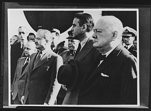 Official pictures of meeting of Stalin, Churchill, Harriman. These are the first official pictures released in the United States of the recent meetings of Premier I.V. Stalin, Union of Soviet Socialist Republics; Prime Minister Winston Churchill of Britain; and W. Averrell Harriman, representing President Roosevelt. The three men met in the middle of August, 1942, at the request of the Soviet leader, and held a series of conversations concerned with the future conduct of the war. Also present was V.M. Molotov, Peoples' Commissar for Foreign Affairs, Union of Soviet Socialist Republics. The meetings lasted four days. Left to right, foreground: Molotov, Harriman, Churchill, reviewing troops at Moscow civil airport while Russian officials look on. Immediately behind Churchill is Admiral Miles, Chief of the British military mission to the Soviet Union