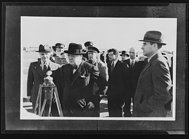 Official pictures of meeting of Stalin, Churchill, Harriman. These are the first official pictures released in the United States of the recent meetings of Premier I.V. Stalin, Union of Soviet Socialist Republics; Prime Minister Winston Churchill of Britain; and W. Averrell Harriman, representing President Roosevelt. The three men met in the middle of August, 1942, at the request of the Soviet leader, and held a series of conversations concerned with the future conduct of the war. Also present was V.M. Molotov, Peoples' Commissar for Foreign Affairs, Union of Soviet Socialist Republics. The meetings lasted four days. Churchill making address over radio while Russian officials look on at Moscow civil airport. Left to right, foreground: Molotov, Churchill, Harriman