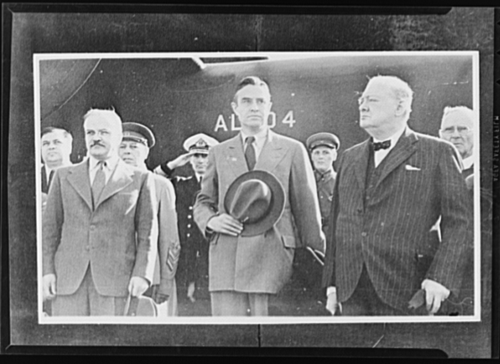 Official pictures of meeting of Stalin, Churchill, Harriman. These are the first official pictures released in the United States of the recent meetings of Premier I.V. Stalin, Union of Soviet Socialist Republics; Prime Minister Winston Churchill of Britain; and W. Averrell Harriman, representing President Roosevelt. The three men met in the middle of August, 1942, at the request of the Soviet leader, and held a series of conversations concerned with the future conduct of the war. Also present was V.M. Molotov, Peoples' Commissar for Foreign Affairs, Union of Soviet Socialist Republics. The meetings lasted four days. Foreground, left to right: Molotov, Harriman and Churchill at Moscow civil airport. Admiral William Harrison Stanley, American Ambassador to the Soviet Union, is behind Churchill at the right of the picture. British Admiral Miles is saluting behind Harriman