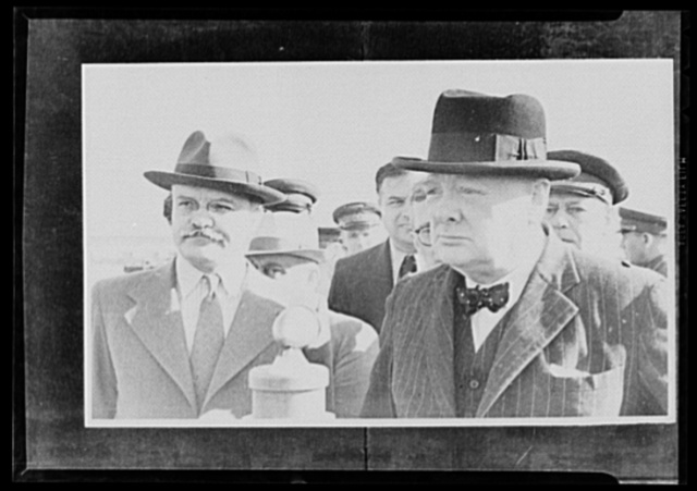 Official pictures of meeting of Stalin, Churchill, Harriman. These are the first official pictures released in the United States of the recent meetings of Premier I.V. Stalin, Union of Soviet Socialist Republics; Prime Minister Winston Churchill of Britain; and W. Averrell Harriman, representing President Roosevelt. The three men met in the middle of August, 1942, at the request of the Soviet leader, and held a series of conversations concerned with the future conduct of the war. Also present was V.M. Molotov, Peoples' Commissar for Foreign Affairs, Union of Soviet Socialist Republics. The meetings lasted four days. Left to right, foreground: Molotov and Churchill at Moscow civil airport