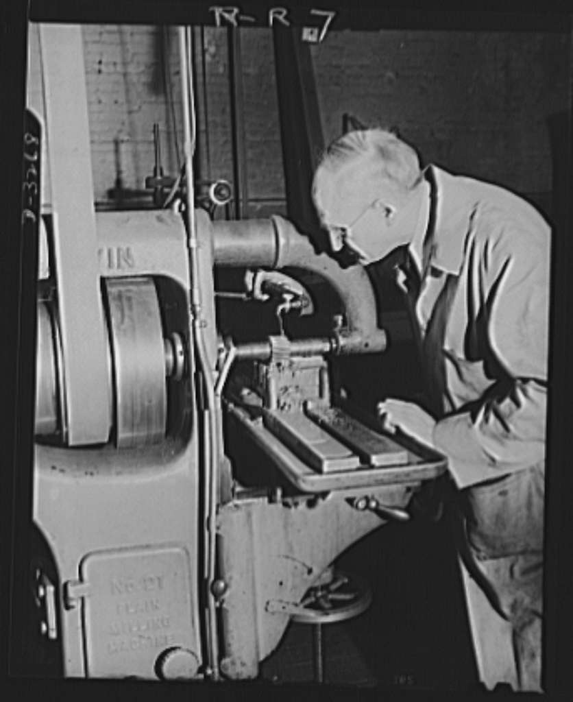 Oil burners to machine gun parts. Machining of a fixture to be used on milling machines which have been converted from production of oil burners to the manufacture of small precision parts for machine guns. Location: a factory in upper New York State. Reif-Rexoil Company, Buffalo, New York