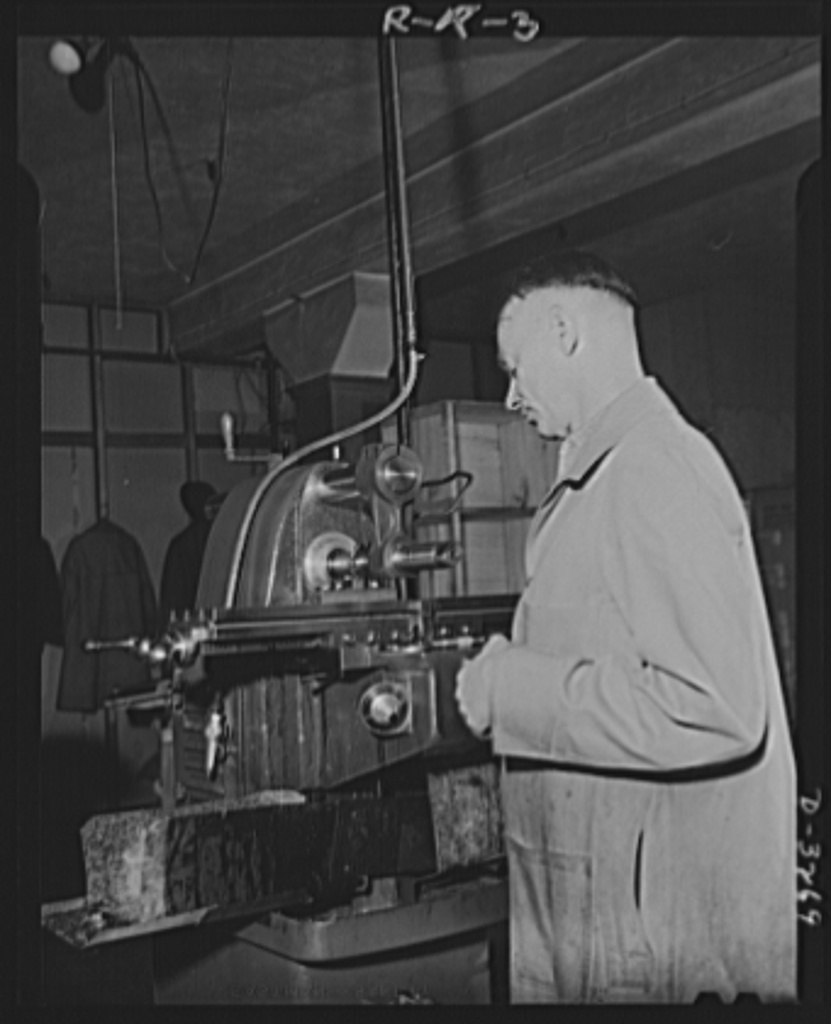 Oil burners to machine gun parts. Oil burners are the normal product of this Eastern factory now undergoing conversion to production of small precision parts for machine guns. This machine has been converted to production of gun parts. Reif-Rexoil Company, Buffalo, New York