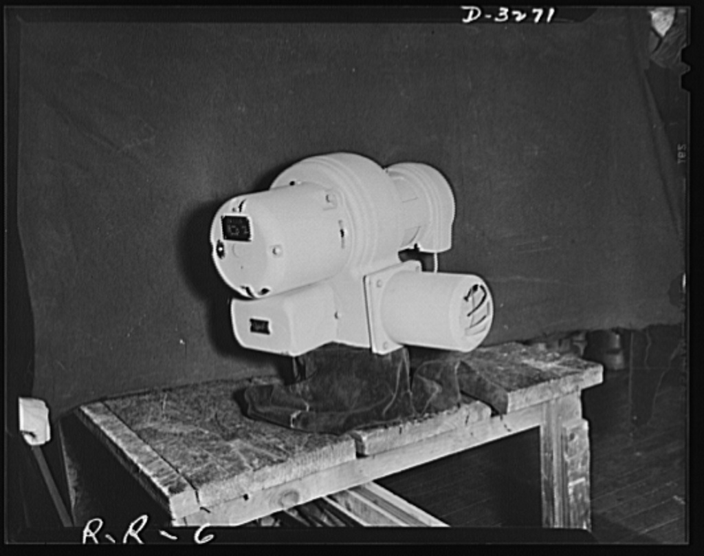 Oil burners to machine gun parts. Painted olive-drab, this oil burner awaits shipment to American armed forces--somewhere in the field. Converted to a large degree to production of precision gun parts, the factory which manufactures these oil burners ships most of them either to the Army or abroad under lend-lease contracts. Reif-Rexoil Company, Buffalo, New York