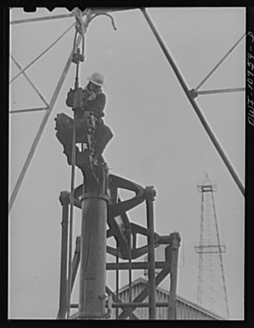 Oklahoma City, Okla. Repairing a pump on an oil well