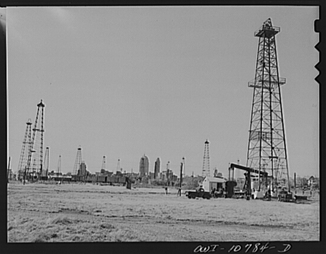 Oklahoma City, Oklahoma. Oil field discovered about 1930. All the wells are now on the pump