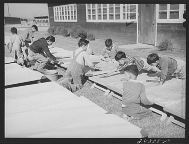 Older boys wash nursery school cots on Saturday morning. Robstown, Texas