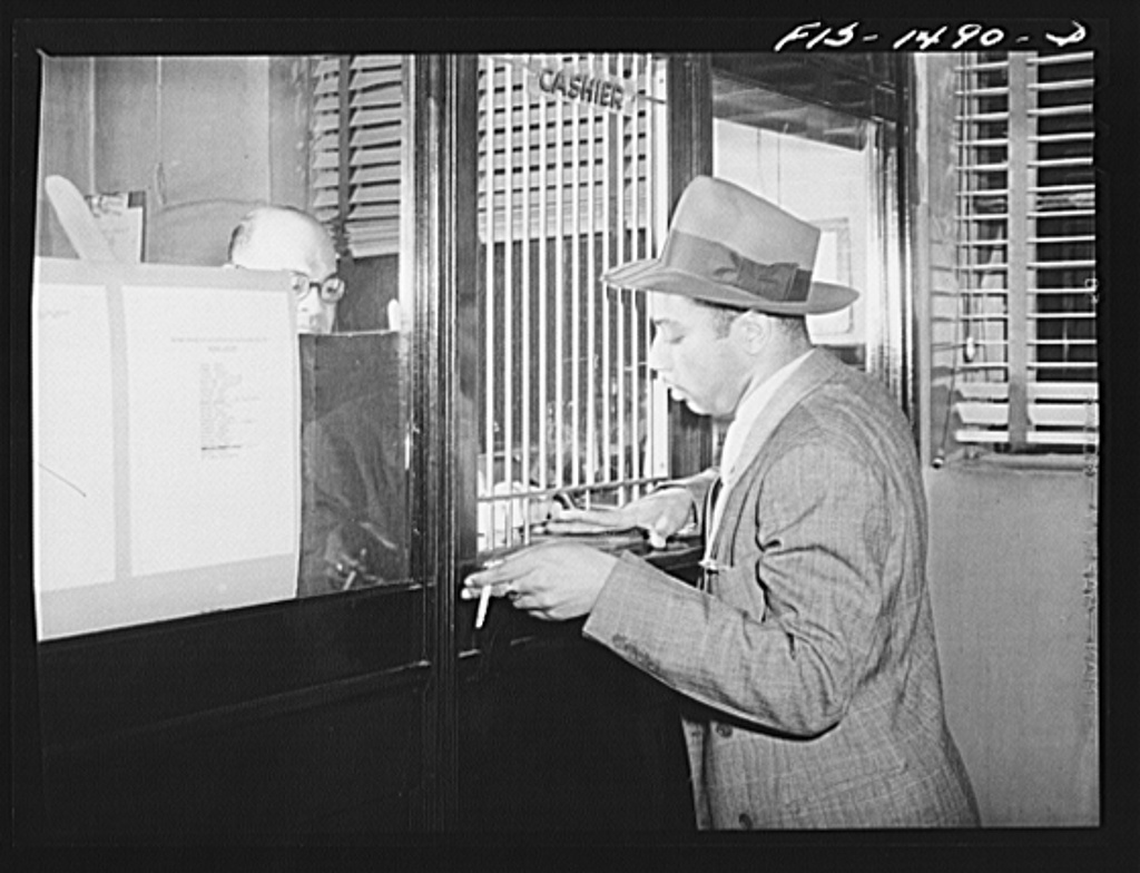 Oliver Coleman, drummer, paying his dues at Musicians' Hall, the headquarters of local 208 of the musicians' union. Chicago, Illinois