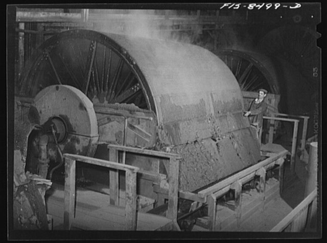 Oliver filter at the Anaconda Copper Mining Company smelter. In this machine flotation concentrates are filtered from the liquid; from this operation the concentrates, which contain about twenty-six percent copper, go directly to the roasting furnace