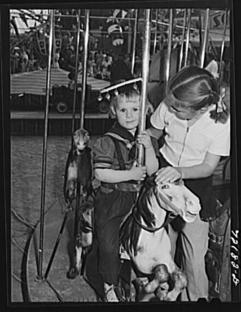 On the merry-go-round. Imperial County Fair, California