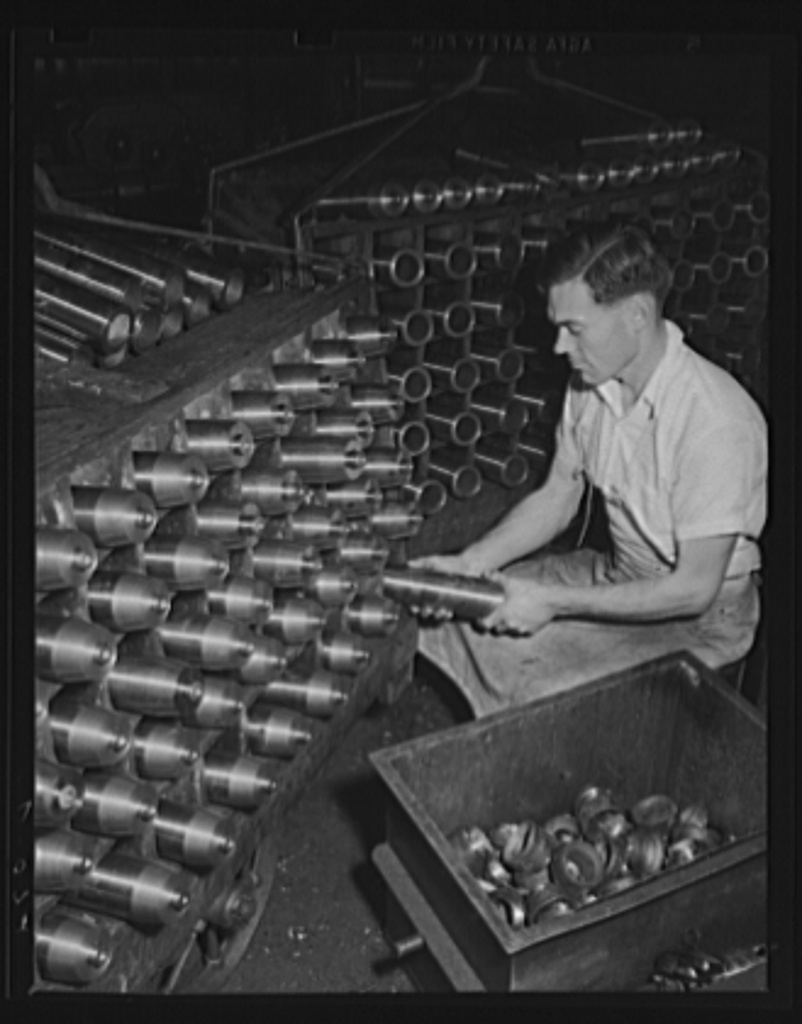 One gun spits 166 of these an hour. 75 mm shells stand as semi-finished ammunition in a large eastern arsenal, which is working at top capacity