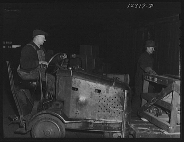 """One of the """"motors"""" used in the freight house at a Chicago and Northwestern Railroad yard for hauling hand dollies loaded with goods"""