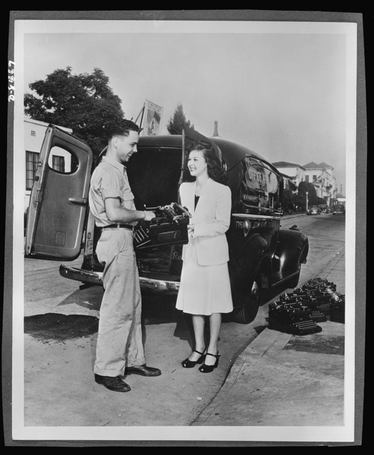 """Paramount Picture star sends her typewriter to war. Susan Hayward, Paramount motion picture star, does her share in sending typewriters to war. Pictures shows Miss Hayward selling her machine to the government as her contribution to the typewriter campaign. Uncle Sam needs 600,000 typewriters for the armed services and is contracting all possible typewriter users to urge them to release """"1 out of 4"""" typewriters for Army and Navy service"""